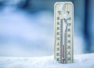 Thermometer on snow shows low temperatures - zero. Low temperatures in degrees Celsius and fahrenheit. Cold winter weather - zero celsius thirty two farenheit Getty Images/iStockphoto