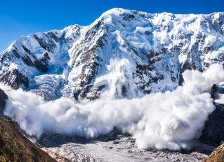 Large avalanche coming down the rocky Caucasus mountain Getty Images/iStockphoto