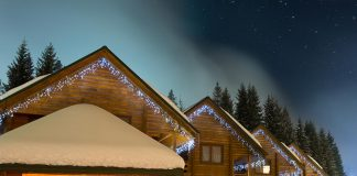 Ski chalets at night Sergey Tryapitsyn
